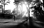 SAN FRANCISCO, CA - JUNE 14:  Sam Osborne and caddie walk up the 7th fairway as the sun sets behind the trees during the first round of the U.S. Open on June 14, 2012 at The Olympic Club in San Francisco, California. Osborne, the world's 1,457th-ranked golfer, qualified for the US Open by winning a qualifier local tournament.  (Photo by Donald Miralle for GolfWorld).