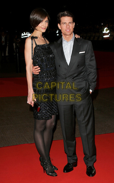 "KATIE HOLMES & TOM CRUISE.At the UK Film Premiere of ""Valkyrie"", Odeon Leicester Square, London, England, January 21st 2009..full length grey gray suit jacket blue black dress beaded navy husband wife tights shoes sandals open toe Escada clutch bag .CAP/AH.©Adam Houghton/Capital Pictures"