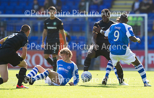St Johnstone v Celtic....15.09.12      SPL  .Gregory Tade and Murray Davidson battle with Victor Wanyama and Scott Brown.Picture by Graeme Hart..Copyright Perthshire Picture Agency.Tel: 01738 623350  Mobile: 07990 594431