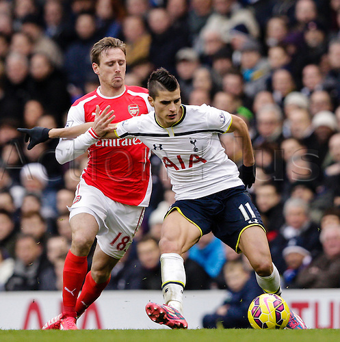 07.02.2015.  London, England. Barclays Premier League. Tottenham Hotspur versus Arsenal.  Tottenham's Erik Lamela in a challenge with Arsenal's Nacho Monreal