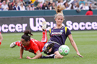 Allison Faulk #7 of the Los Angeles Sol battles for a loose ball against Lisa De Vanna #17 of the Washington Freedom during their inaugural match at Home Depot Center on March 29, 2009 in Carson, California.