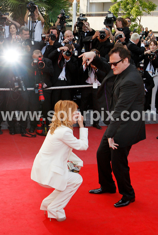 **ALL ROUND PICTURES FROM SOLARPIX.COM**.**SYNDICATION RIGHTS FOR UK AND SPAIN ONLY**.Arrivals at the premiere of Inglourious Basterds at the 62nd Cannes Film Festival in Cannes, France. .This pic:  Quentin Tarantino & Melanie Laurent.JOB REF:      9067    CPR/Heinz        DATE:  21.05.09.**MUST CREDIT SOLARPIX.COM OR DOUBLE FEE WILL BE CHARGED**.**ONLINE USAGE FEE GBP 50.00 PER PICTURE - NOTIFICATION OF USAGE TO PHOTO @ SOLARPIX.COM**.**CALL SOLARPIX : +34 952 811 768 or LOW RATE FROM UK 0844 617 7637**