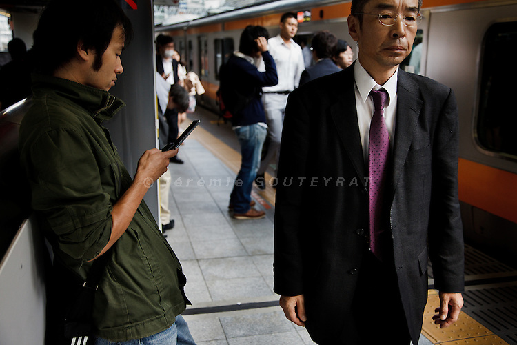 Tokyo, October 25 2011 - On a plateform of Shinjuku train station in the morning.