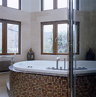 A family-sized Jacuzzi dominates the main bathroom and has views across the garden from the dual-aspect windows
