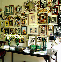 In the hallway the wall is covered in a collection of framed family photographs
