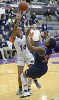NWA Democrat-Gazette/ANDY SHUPE<br /> Coriah Beck (14) of Fayetteville takes a shot as she is pressured by Danielle Dickerson (33) of Heritage Tuesday, Feb. 13, 2018, during the first half of play in Bulldog Arena in Fayetteville. Visit nwadg.com/photos to see more photographs from the games.