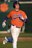 Designated hitter Davis Sharpe (30) of the Clemson Tigers runs toward first against the Stony Brook Seawolves on Friday, February 21, 2020, at Doug Kingsmore Stadium in Clemson, South Carolina. Clemson won, 2-0. (Tom Priddy/Four Seam Images)