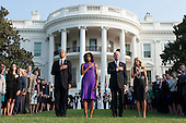 United States President Barack Obama (L), First Lady Michelle Obama, Vice President Joe Biden, Dr. Jill Biden and White House staff place their hands on their heats as taps is played after a moment of silence for the 12 anniversary of the 9/11 terrorist attacks, at the White House on September 11, 2013 in Washington, D.C. <br /> Credit: Kevin Dietsch / Pool via CNP