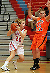 SIOUX FALLS, SD - JANUARY 22:  Shelby Merritt #22 from Lincoln makes a move past Ellie Benson #44 from Washington in the first half of their game Tuesday night at Lincoln. (Photo by Dave Eggen/Inertia)