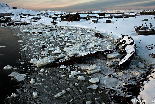 Sunken boats and abandoned houses lay rotting by an icy bay in Teriberka, a vibrant fishing and farming community after WWII. Teriberka's population shrunk from about 14,000 at its height to just more than 1,000 today after the fishing industry collapsed, the town's administrative status was lowered and people moved south to seek work. .Today, Teriberka is again in the spot-light with the construction of a base there for the landing of the gas pipeline from the world's largest known natural gas field.