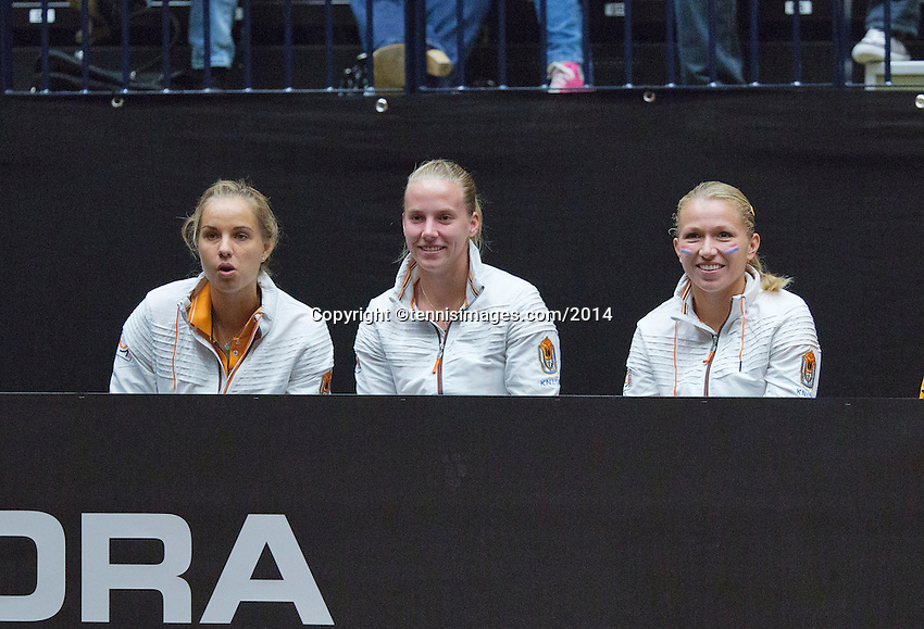 The Netherlands, Den Bosch, 16.04.2014. Fed Cup Netherlands-Japan, l.t.r.: Arantxa Rus, Richel Hogenkamp and Michaella Krajicek support Kiki Bertens<br /> Photo:Tennisimages/Henk Koster