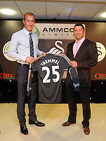 Wednesday 07 May 2014<br /> Pictured: Goalkeeper Gerhard Tremmel (L) with sponsor<br /> Re: Swansea City's annual awards dinner the Liberty Stadium, Swansea, south Wales.
