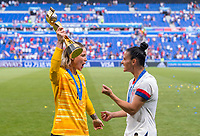 LYON,  - JULY 7: Ashlyn Harris #18, Ali Krieger #11 celebrate with the FIFA Women's World Cup trophy. during a game between Netherlands and USWNT at Stade de Lyon on July 7, 2019 in Lyon, France.