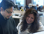 Teresa Vargas and Eli Reyes in cityroom of Newsday Melville office on Saturday March 26, 2005. (Photo Jim Peppler 2005).
