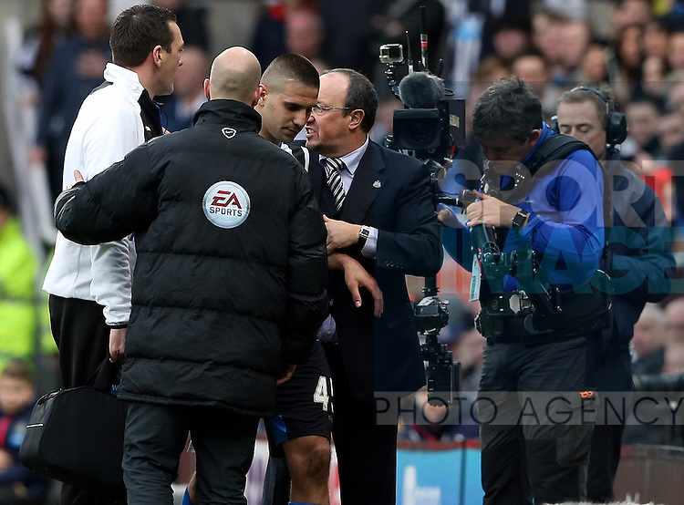 Newcastle United's Aleksandar Mitrovic, center, is told hes not allowed back on to the pitch during the Barclays Premier League match at St James' Park Stadium. Photo credit should read: Scott Heppell/Sportimage
