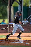 Bristol Pirates right fielder Conner Uselton (25) follows through on a swing during a game against the Elizabethton Twins on July 28, 2018 at Joe O'Brien Field in Elizabethton, Tennessee.  Elizabethton defeated Bristol 5-0.  (Mike Janes/Four Seam Images)