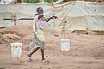 A woman carries water in the Doro Refugee Camp in Maban County, South Sudan. Doro is one of four camps in Maban which together shelter more than 130,000 refugees from the Blue Nile region of Sudan. Jesuit Refugee Service, with support from Misean Cara, provides educational and psycho-social services to both refugees and the host community.