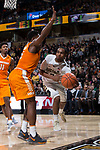 Brandon Childress (0) of the Wake Forest Demon Deacons passes the ball around Admiral Schofield (5) of the Tennessee Volunteers during second half action at the LJVM Coliseum on December 23, 2017 in Winston-Salem, North Carolina.  The Volunteers defeated the Demon Deacons 79-60.  (Brian Westerholt/Sports On Film)