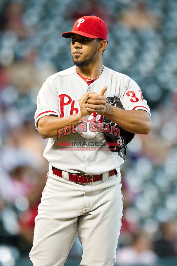 Philadelphia Phillies pitcher Antonio Bastardo #37 rubs the baseball during the Major League baseball game against the Houston Astros on September 16th, 2012 at Minute Maid Park in Houston, Texas. The Astros defeated the Phillies 7-6. (Andrew Woolley/Four Seam Images).