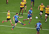 14th June 2020, Aukland, New Zealand;  Beauden Barrett kicks forward at the Investec Super Rugby Aotearoa match, between the Blues and Hurricanes held at Eden Park, Auckland, New Zealand.