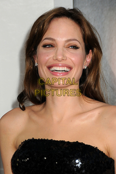 "ANGELINA JOLIE .""Salt"" Los Angeles Premiere held at Grauman's Chinese Theatre, Hollywood, California, USA, 19th July 2010..portrait headshot strapless sequined sequin black diamond stud earrings mouth open smiling .CAP/ADM/BP.©Byron Purvis/AdMedia/Capital Pictures."