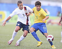 Danny Szetela moves in on Alexandre Pato. USA stunned Brazil, winning 2-1 to finish first in their group. Final game in group D in Ottawa, Ontario, on JULY 6 2007.
