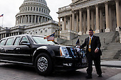 A staff member buffs the presidential limousine while it is parked outside the U.S. Capitol March 12, 2013 in Washington, DC. U.S. President Barack Obama met with the Senate Democratic Caucus today, and is making three trips to Capitol Hill this week to meet with lawmakers.  .Credit: Drew Angerer / Pool via CNP