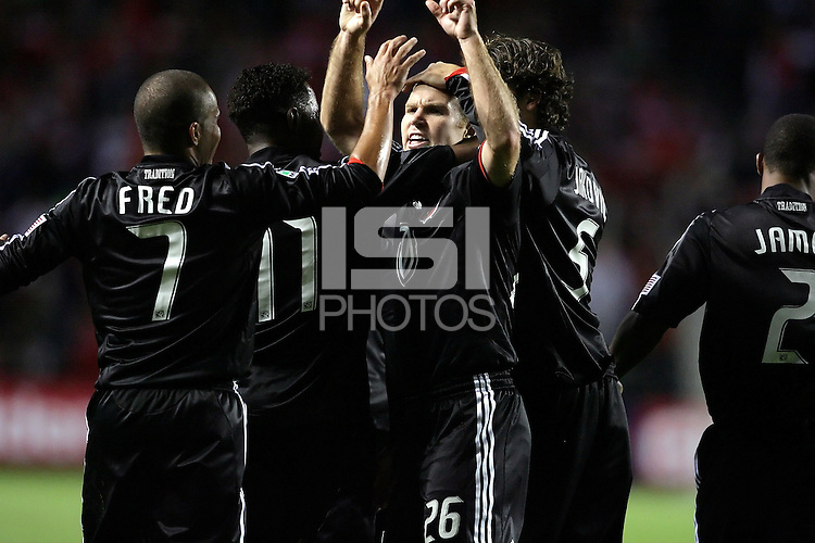 DC United defender Brian Namoff (26, center) celebrates with his teammates Fred (7), Luciano Emilio (11), and Dejan Jakovic (5) after scoring the game's only goal.  The DC United defeated the Chicago Fire 1-0 at Toyota Park in Bridgeview, IL on August 29, 2009.