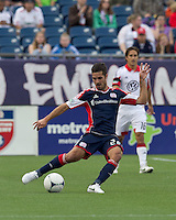 New England Revolution midfielder Benny Feilhaber (22) passes the ball. In a Major League Soccer (MLS) match, DC United defeated the New England Revolution, 2-1, at Gillette Stadium on April 14, 2012.