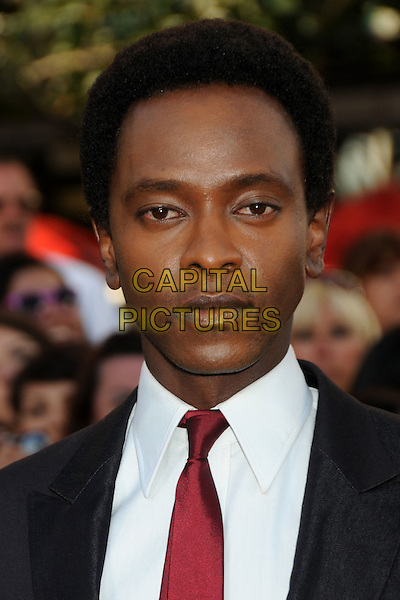 "EDI GATHEGI.""The Twilight Saga: Eclipse"" Los Angeles Premiere at the 2010 Los Angeles Film Festival held at Nokia Theatre LA Live, Los Angeles, California, USA, 24th June 2010..portrait headshot red tie white shirt .CAP/ADM/BP.©Byron Purvis/AdMedia/Capital Pictures."