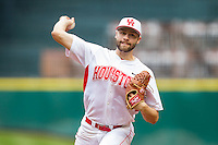 Houston Cougars starting pitcher Aaron Garza #21 delivers a pitch to the plate against the Texas Tech Red Raiders at Minute Maid Park on February 28, 2014 in Houston, Texas.  The Cougars defeated the Red Raiders 9-0.  (Brian Westerholt/Four Seam Images)