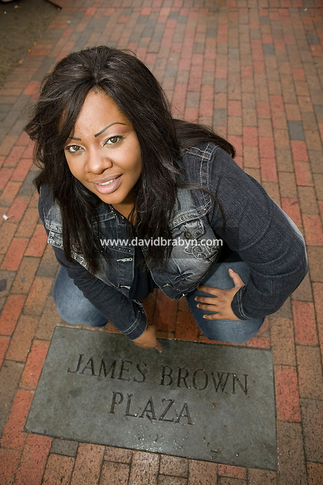 French singer and runner-up of La Nouvelle Star TV show, Miss Dominique poses at the James Brown Plaza on Broad Street in Augusta, USA, 31 December 2006. Miss Dominique is in the US to attend funeral events for James Brown.
