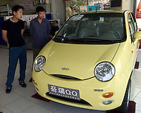 Two men inquire about a Chery QQ at a Chery showroom in Beijing, China..