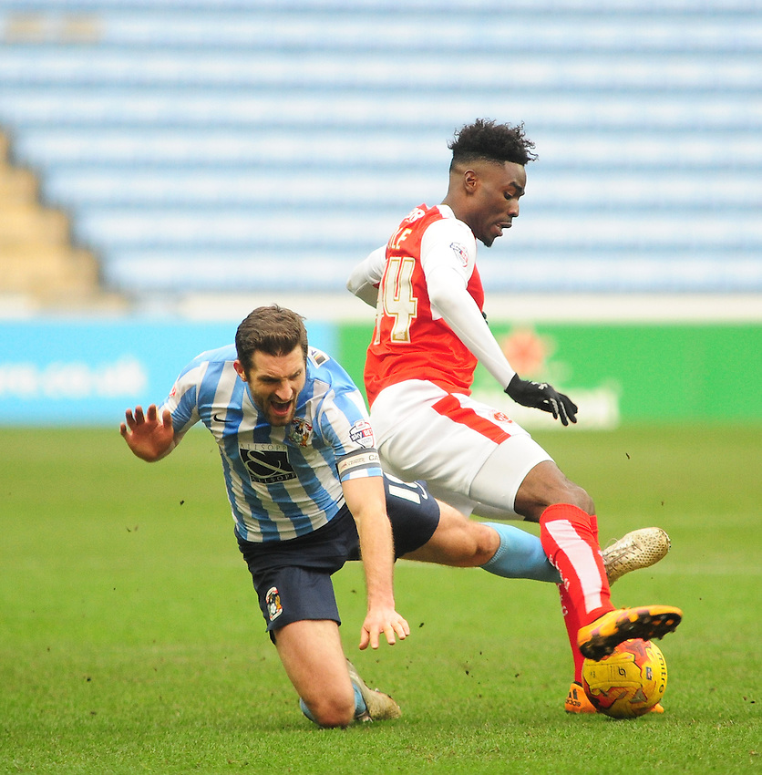 Coventry City's Sam Ricketts vies for possession with Fleetwood Town's Devante Cole<br /> <br /> Photographer Andrew Vaughan/CameraSport<br /> <br /> Football - The Football League Sky Bet League One - Coventry City v Fleetwood Town - Saturday 27th February 2016 - Ricoh Stadium - Coventry   <br /> <br /> &copy; CameraSport - 43 Linden Ave. Countesthorpe. Leicester. England. LE8 5PG - Tel: +44 (0) 116 277 4147 - admin@camerasport.com - www.camerasport.com