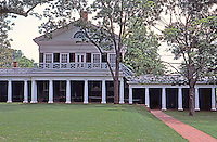 Thomas Jefferson: University of Virginia--view across lawn to Pavilion, showing terracing and break in line of student quarters.  Photo '85.