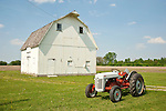 Ford 8N tractor (1950), white wooden barn, Pontiac, Ill.