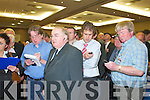 .1294-1298.Party supporters gather around the large screen that display the figures during the first count at the South Kerry count in The Malton Hotel, Killarney, last Friday morning...