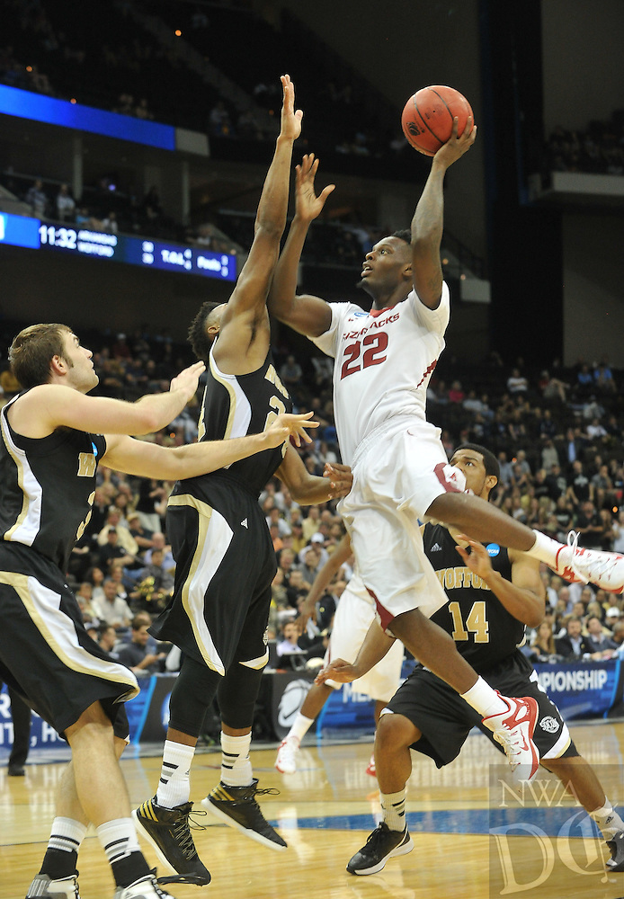 NWA Democrat-Gazette/Michael Woods --03/19/2015--w@NWAMICHAELW... University of Arkansas forward Jacorey Williams drives to the hoop in the second half of Thursday nights 56-53 win against the Wofford Terriers in the 2015 NCAA basketball tournament at Jacksonville Veterans Memorial Arena in Jacksonville, Florida.