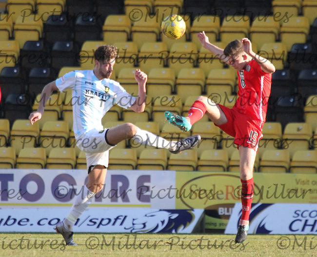 Jack Baird (15) and Jordan White go for the ball in the Livingston v St Mirren Scottish Professional Football League Ladbrokes Championship match played at the Tony Macaroni Arena, Livingston on 19.3.16.