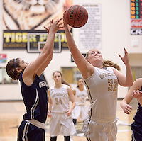 NWA Democrat-Gazette/BEN GOFF @NWABENGOFF<br /> Ashley Murch (32) of Bentonville wins a rebound over Kyiah Julian of Greenwood on Thursday Dec. 17, 2015 during the game in Bentonville's Tiger Arena.