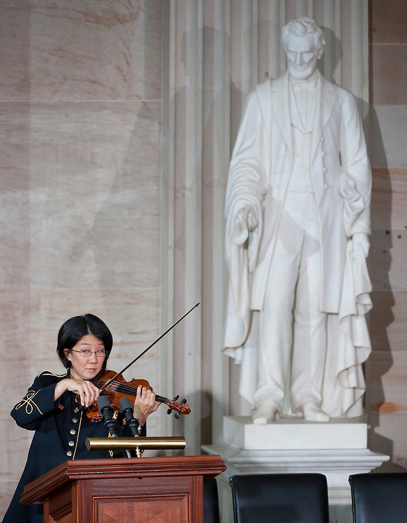 """UNITED STATES - MAY 17: U.S. Army Band Violin Soloist SSG Annette Barger plays the theme from """"Schindlers' List"""" as the National Days of Remembrance commemoration of the Holocaust begins in the U.S. Capitol Rotunda on Tuesday, May 17, 2011. (Photo By Bill Clark/Roll Call)"""