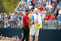 Tiger Woods (USA) shakes hands with his caddie Joe LaCava after finishing on the 18th hole during the final round of the 100th PGA Championship at Bellerive Country Club, St. Louis, Missouri, USA. 8/12/2018.<br /> Picture: Golffile.ie | Brian Spurlock<br /> <br /> All photo usage must carry mandatory copyright credit (&copy; Golffile | Brian Spurlock)