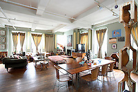 Eclectic living room with open plan kitchen