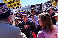 Washington, DC - March 16, 2019: Two men on different sides of the Venezuelan crisis confront each other as hundreds gather in front of the White House in Washington, D.C. to protest political events in Venezuela March 16, 2019.  (Photo by Don Baxter/Media Images International)