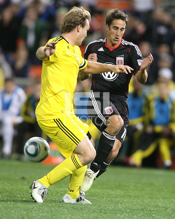 Josh Wolfe#16 of D.C. United clashes with Chad Marshall#14 of the Columbus Crew during the opening match of the 2011 season at RFK Stadium, in Washington D.C. on March 19 2011.D.C. United won 3-1.