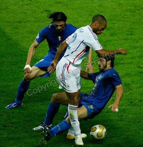 Jul 9, 2006; Berlin, GERMANY; Italy midfielder (8) Gennaro Gattuso tackles France forward (12) Thierry Henry during extra time play as forward (15) Vincenzo Iaquinta looks on in the final of the 2006 FIFA World Cup at the Olympiastadion, Berlin. Italy defeated France 5-3 on penalty kicks following a 1-1 draw after extra time to win the World Cup. Mandatory Credit: Ron Scheffler-US PRESSWIRE Copyright © Ron Scheffler
