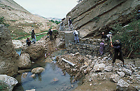 Projet  workers repairing water spring damaged from erosion