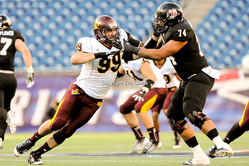 Central Michigan Chippewas defensive end Caesar Rodriguez (99) and Massachusetts Minutemen offensive linesman Stephane Milhim (74) during the Central Michigan Chippewas vs Massachusetts Minutemen NCAA football game held at Gillette Stadium in Foxborough, Massachusetts.  Eric Canha/CSM