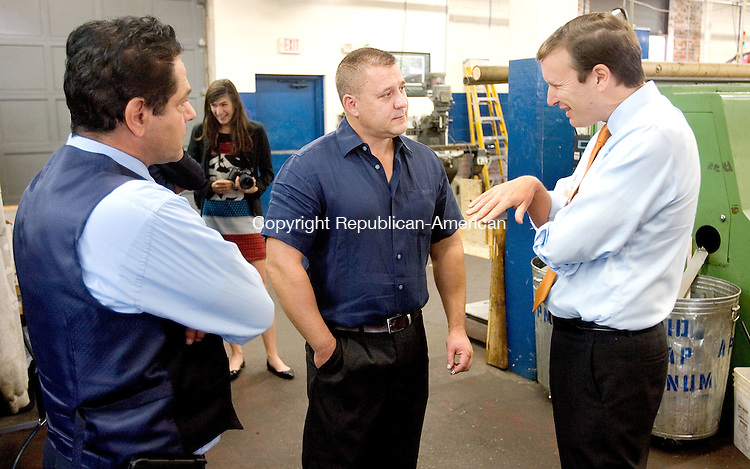 ANSONIA CT. 14 October 2015-101315SV03-Sen. Christopher S. Murphy, D-Conn., right, talks with Leigh Dawid, owner, and Dave Cassetti, mayor, left, at American Precision Manufacturing in Ansonia Wednesday. <br /> Steven Valenti Republican-American