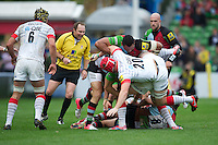 Andy Saull of Saracens is summarily removed from the tackle area by Maurie Fa'asavalu of Harlequins during the Aviva Premiership match between Harlequins and Saracens at the Twickenham Stoop on Sunday 30th September 2012 (Photo by Rob Munro)